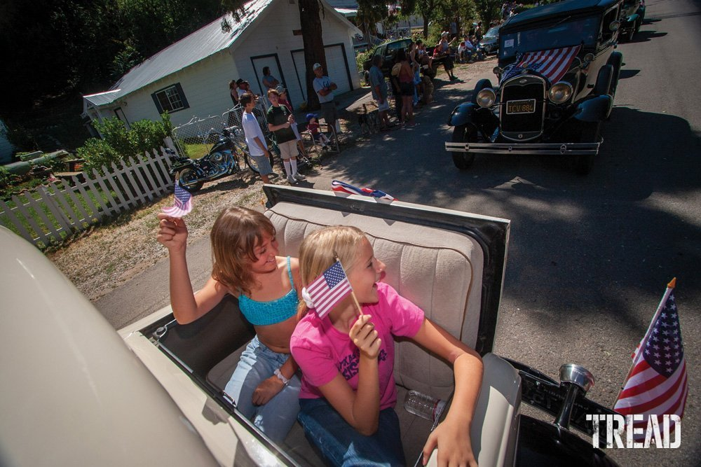 Two girls in a Fourth of July parade.